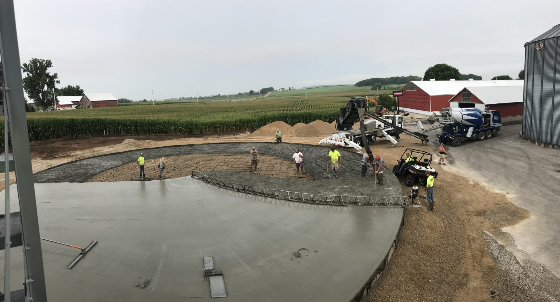 Workers creating a custom concrete design