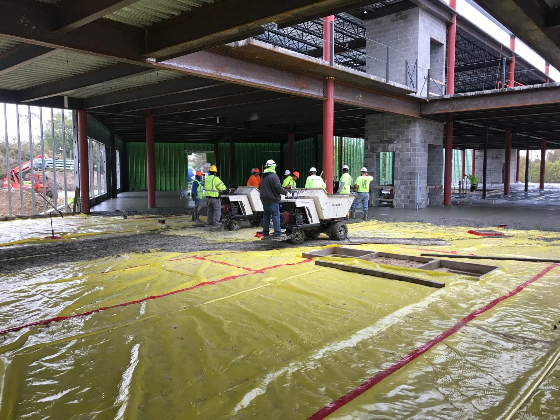 Workers adding fiber concrete to a new building being built